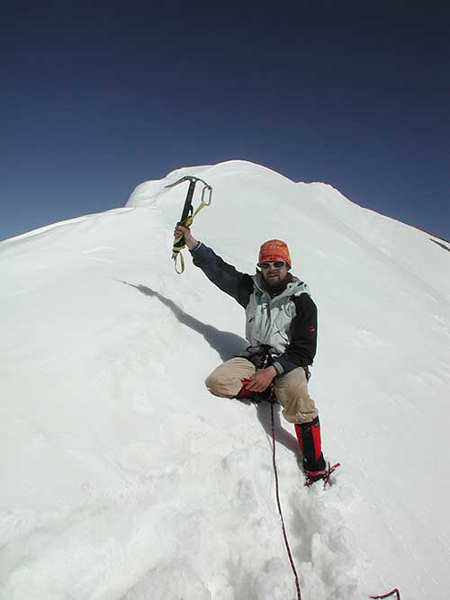 Erik Tanghe on the summit of Mont Brulé